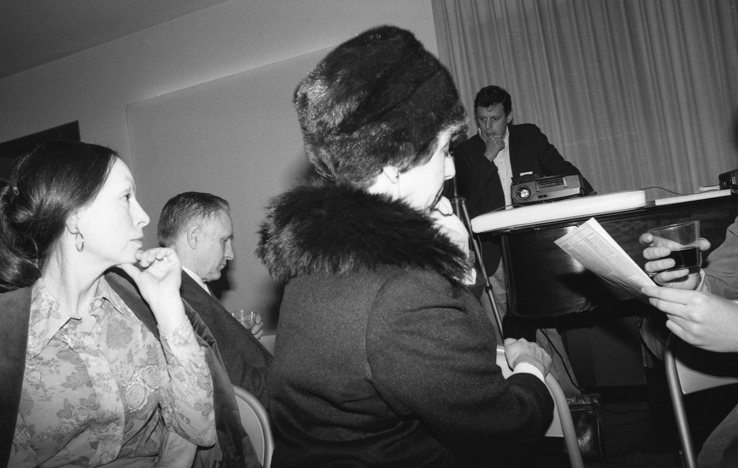 Philip Glass making a presentation at salon given by Betty Freeman, Los Angeles, 1981.