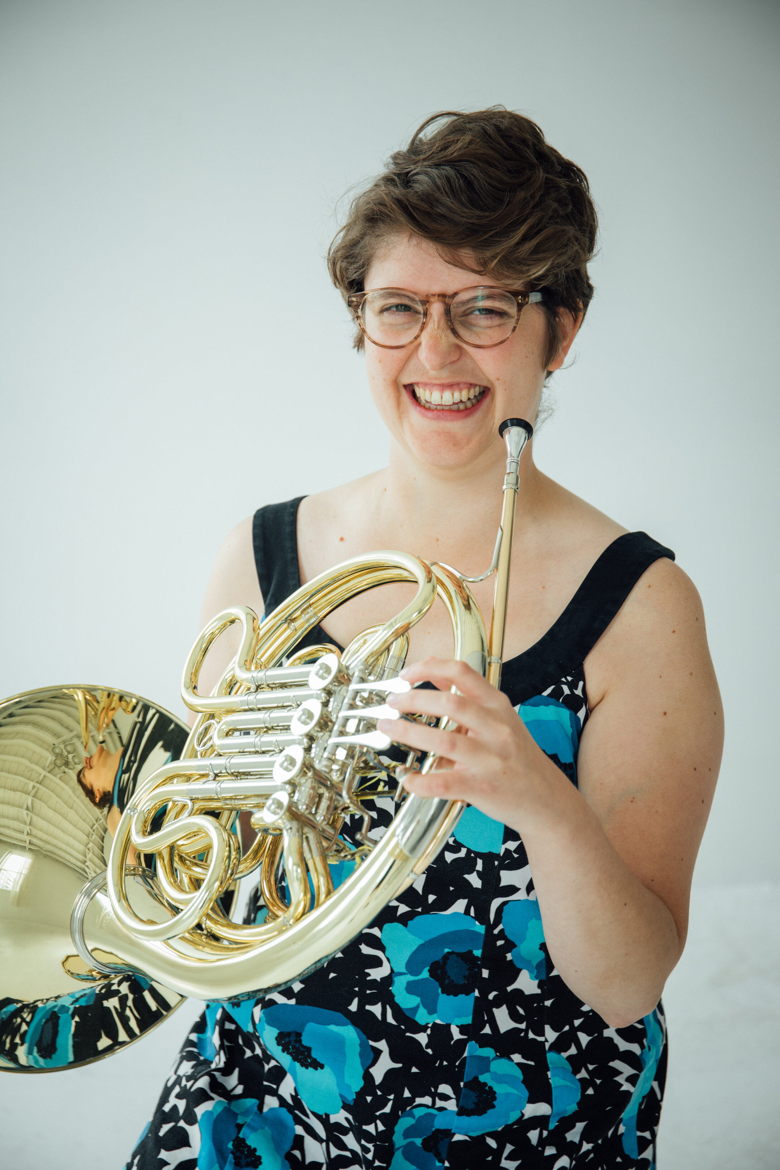 Rebecca Olason, horn - Hornist and educator Rebecca Olason is passionate about music both as a tradition and as a living art form. In addition to performing with Onomatopoeia, she is a member of the Rose City Brass Quintet. She was the fourth horn in the Newport Symphony and Portland Columbia Symphony Orchestra, and performs as a substitute with various orchestras in the Pacific Northwest, including the Oregon Symphony and Oregon Ballet Theater orchestra.As an avid and passionate teacher, Rebecca's goal is to help her students discover their passions and goals in music. She has taught at Clackamas Community College, George Fox University, her own private studio and in clinics across the tri-county area.Rebecca graduated Summa Cum Laude from the University of Oregon with a Bachelors of Music in Horn Performance and with a Masters of Music in Horn Performance from the Peabody Conservatory of the Johns Hopkins University, where she studied with Lydia Van Dreel and Denise Tryon, respectively.