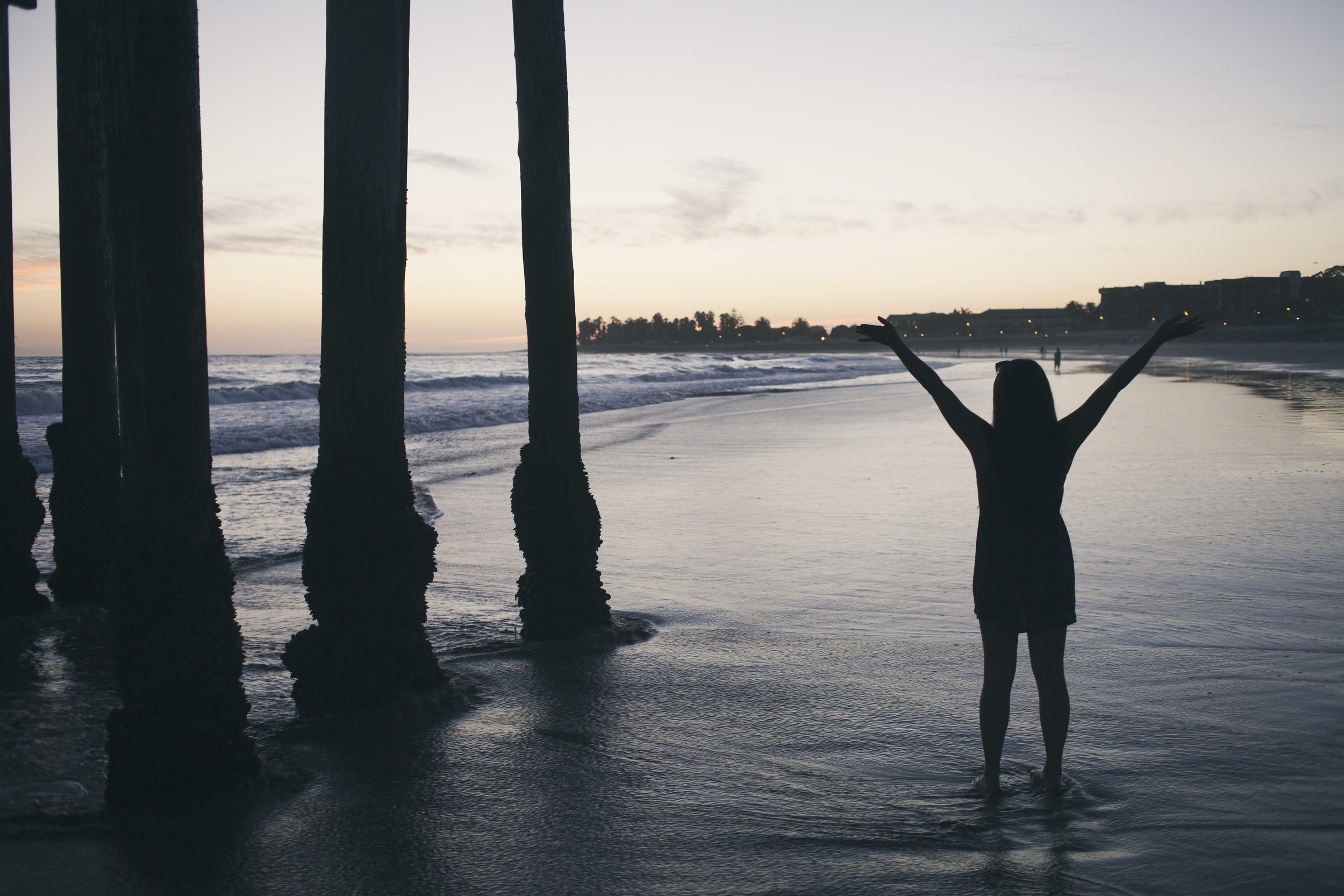 silhouette-of-woman-standing-with-arms-raised-in-the-water.jpg