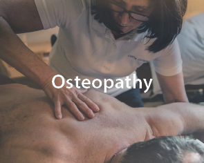 Practitioner performing osteopathy on man's back