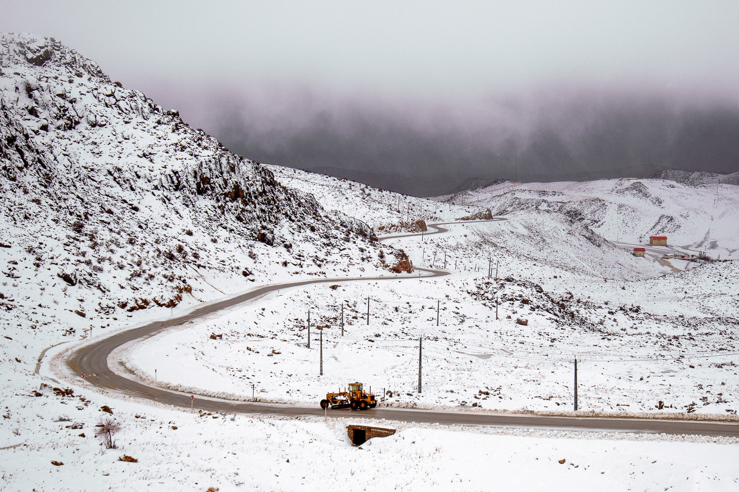 Winding roads are clean for traffic as a result of Hamid, Ismaeil and their colleagues' hard work!