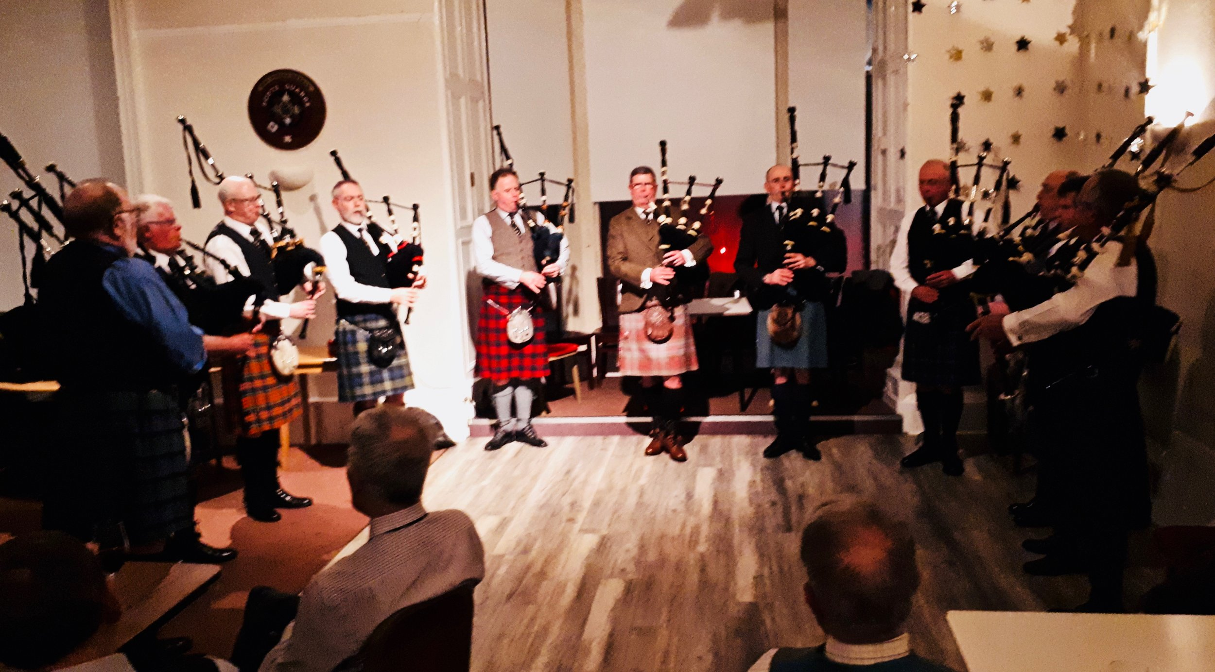 The Eagle Piper's Society on the floor