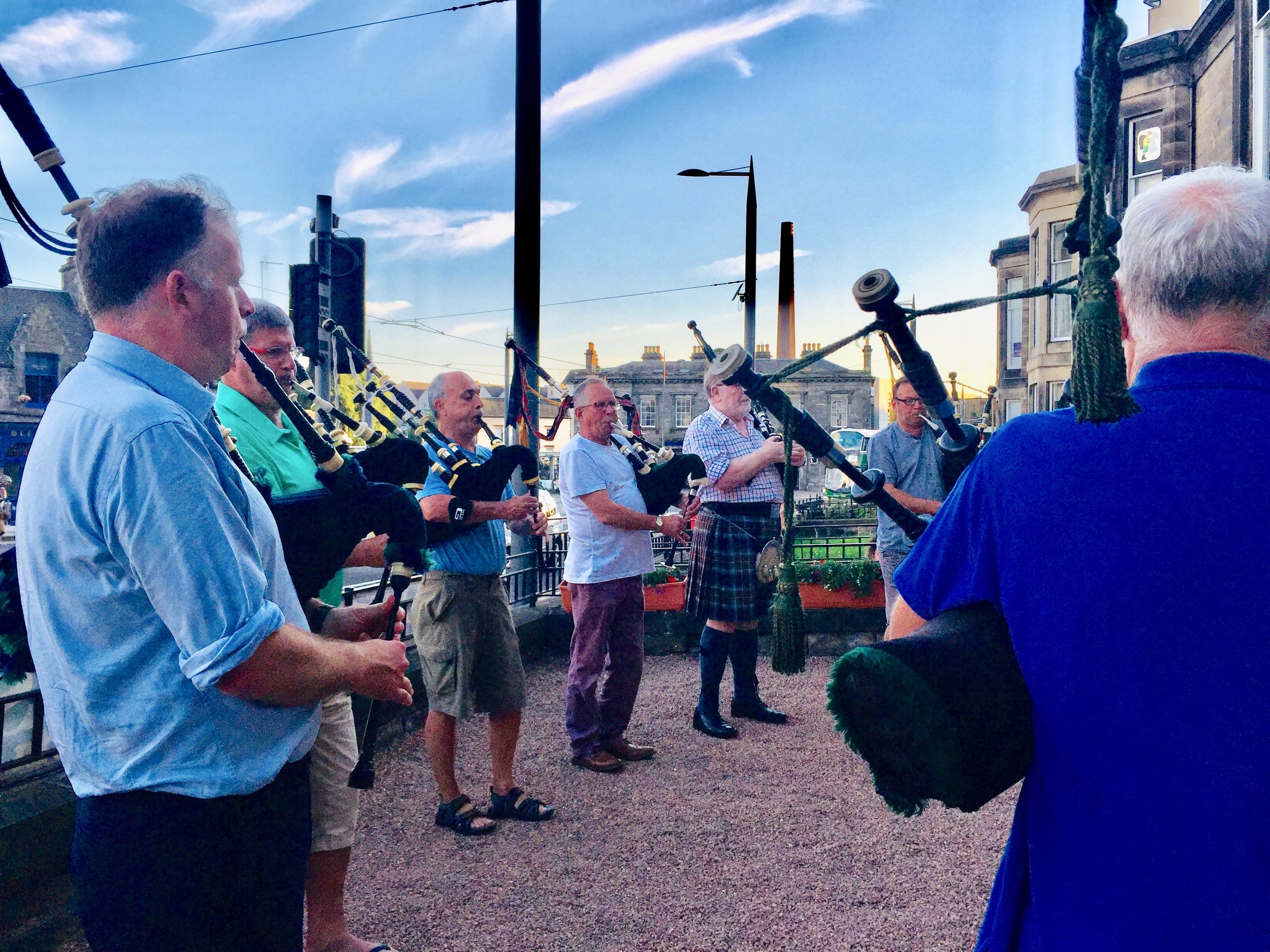 The Eagle Pipers' Society having a tune outside the Scots Guards Association Club