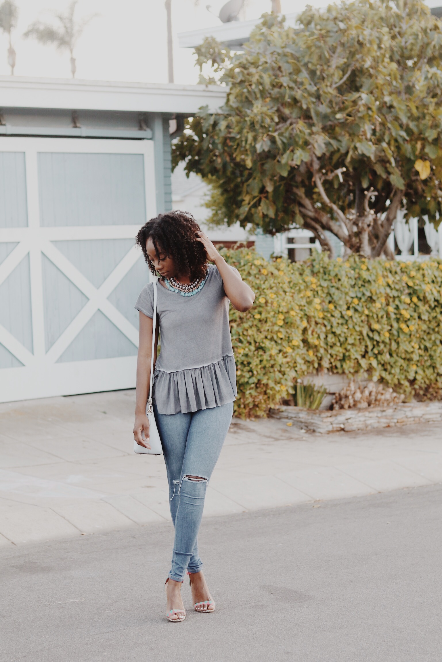 The most perfect ruffle tee for a casual look from Shop Pink Blush.