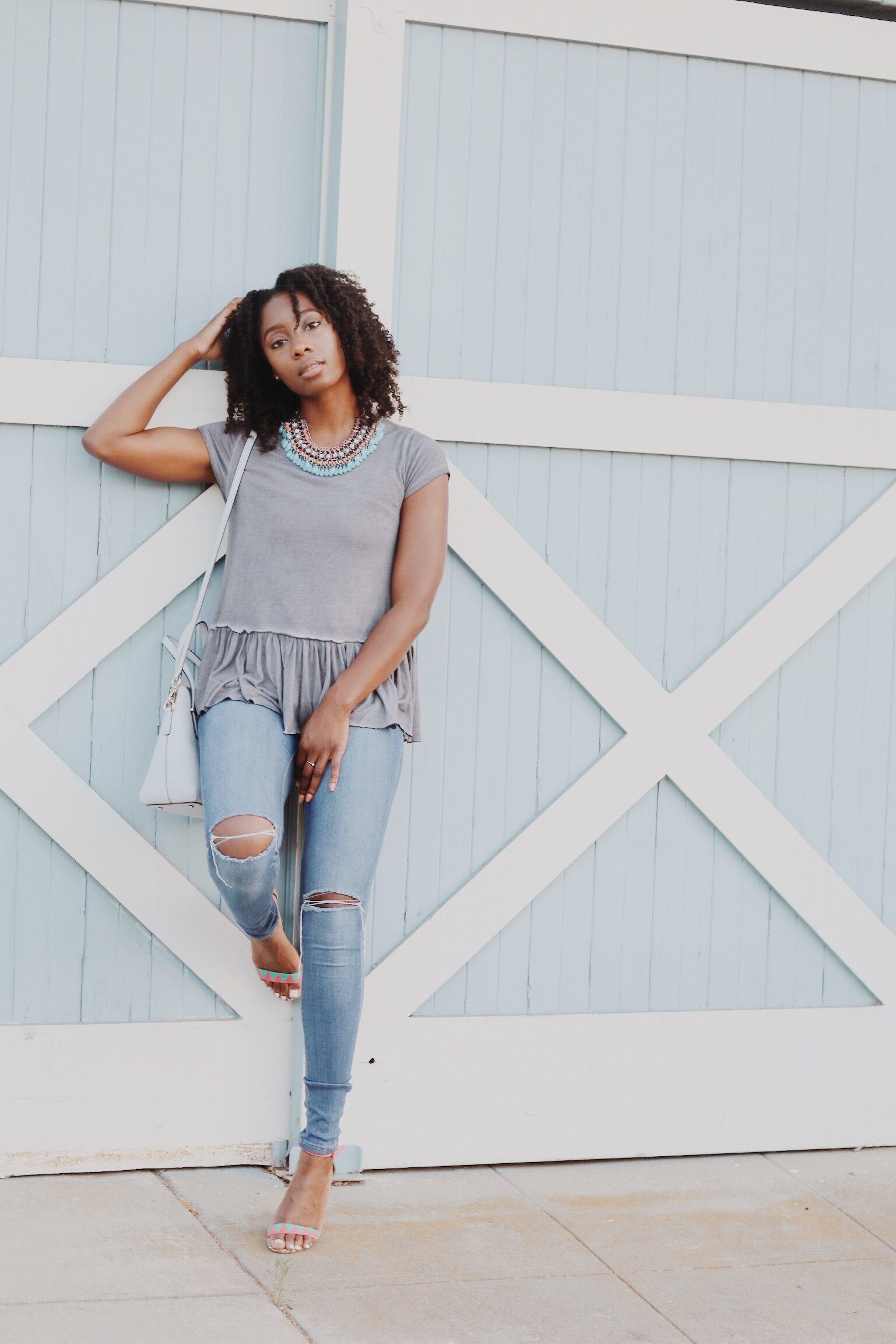 I styled my Shop Blush Pink tee with my favorite fashion nova jeans!