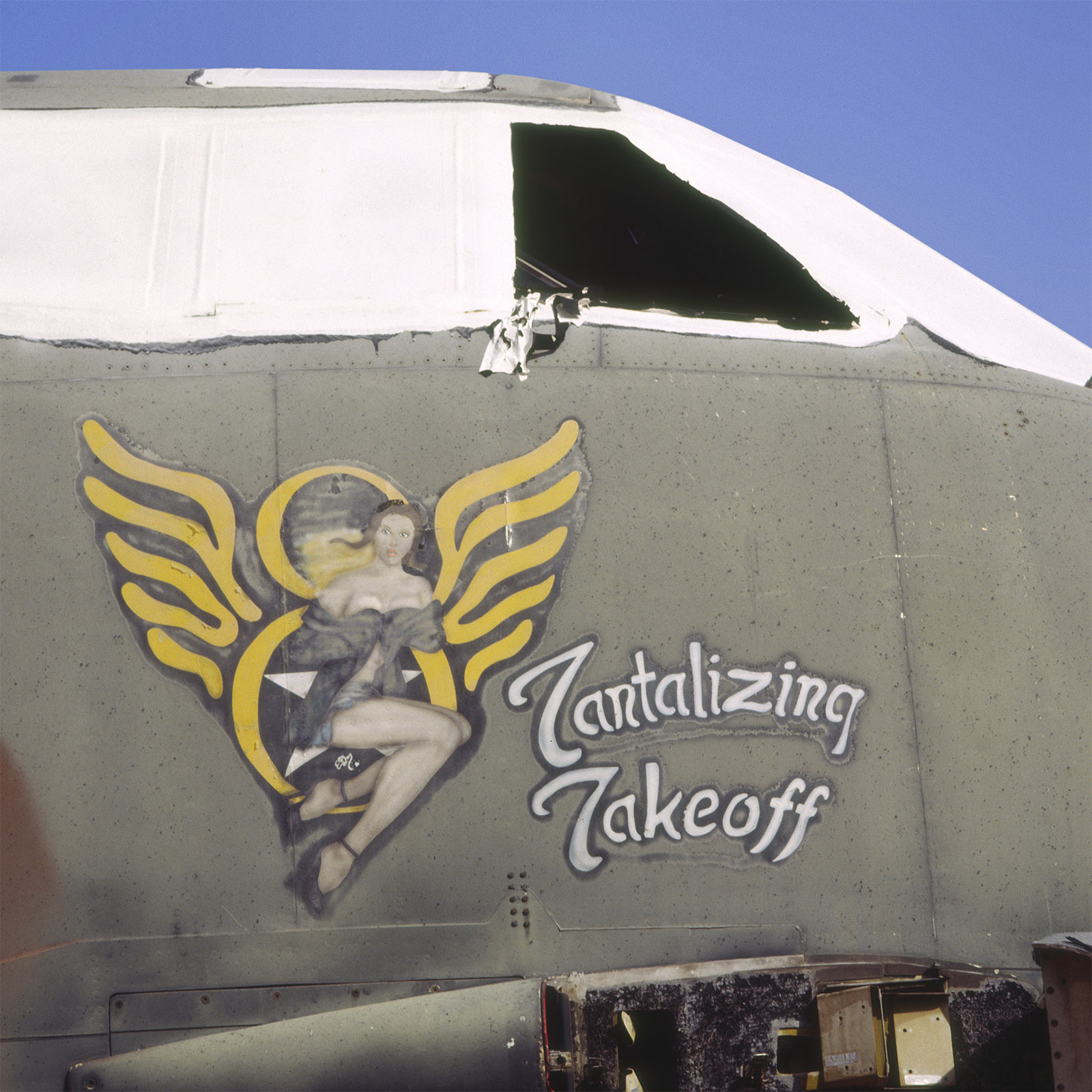 tantalizing takeoff nose art - rev.jpg