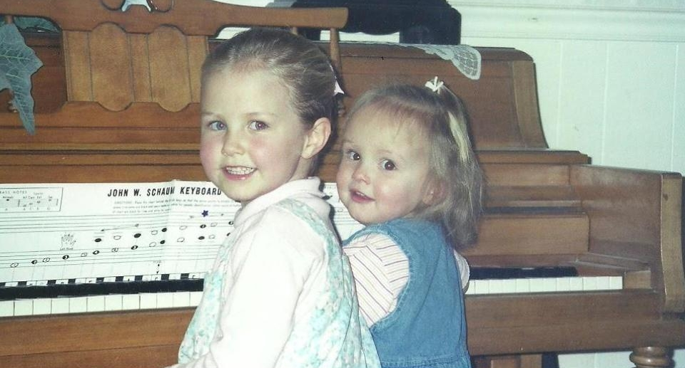 Five-year-old me at the piano with my little sister, Nikki!