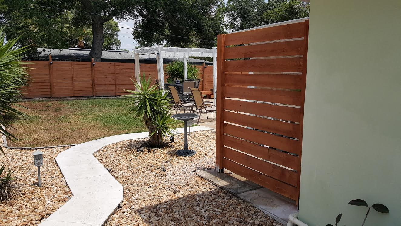 Flow is Important - Coming into the pool area you see the trellis, the pedestals and this beautiful fence .