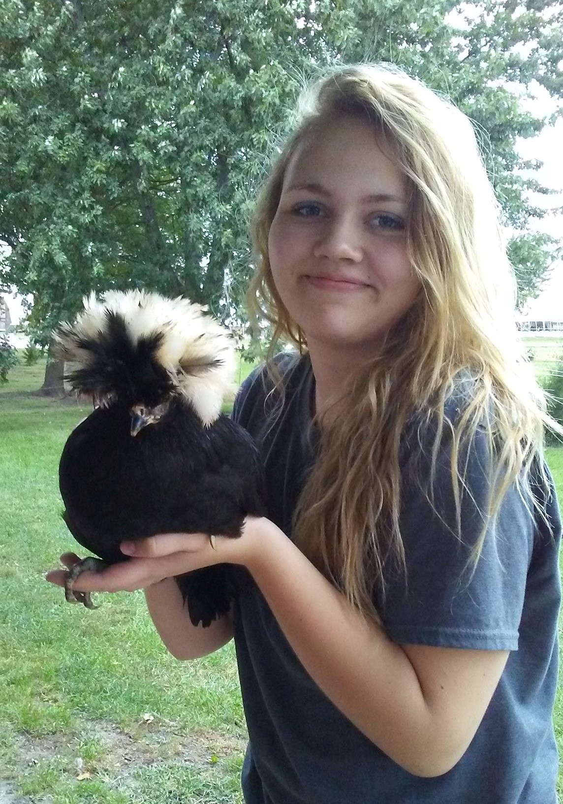 """B~ and her favorite """"crazy-haired"""" chicken"""