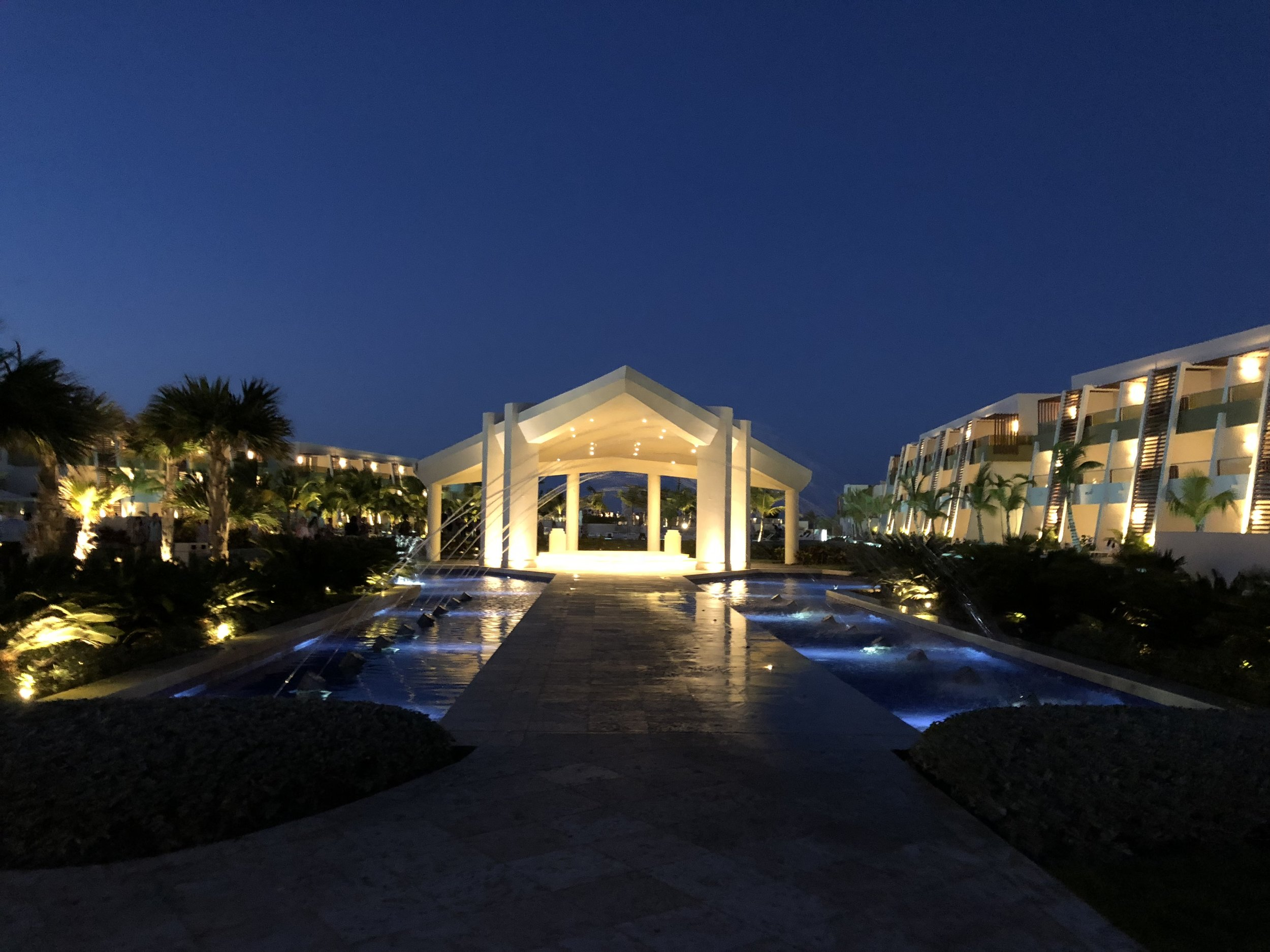 A night view of the fountain walkway to the main pool.