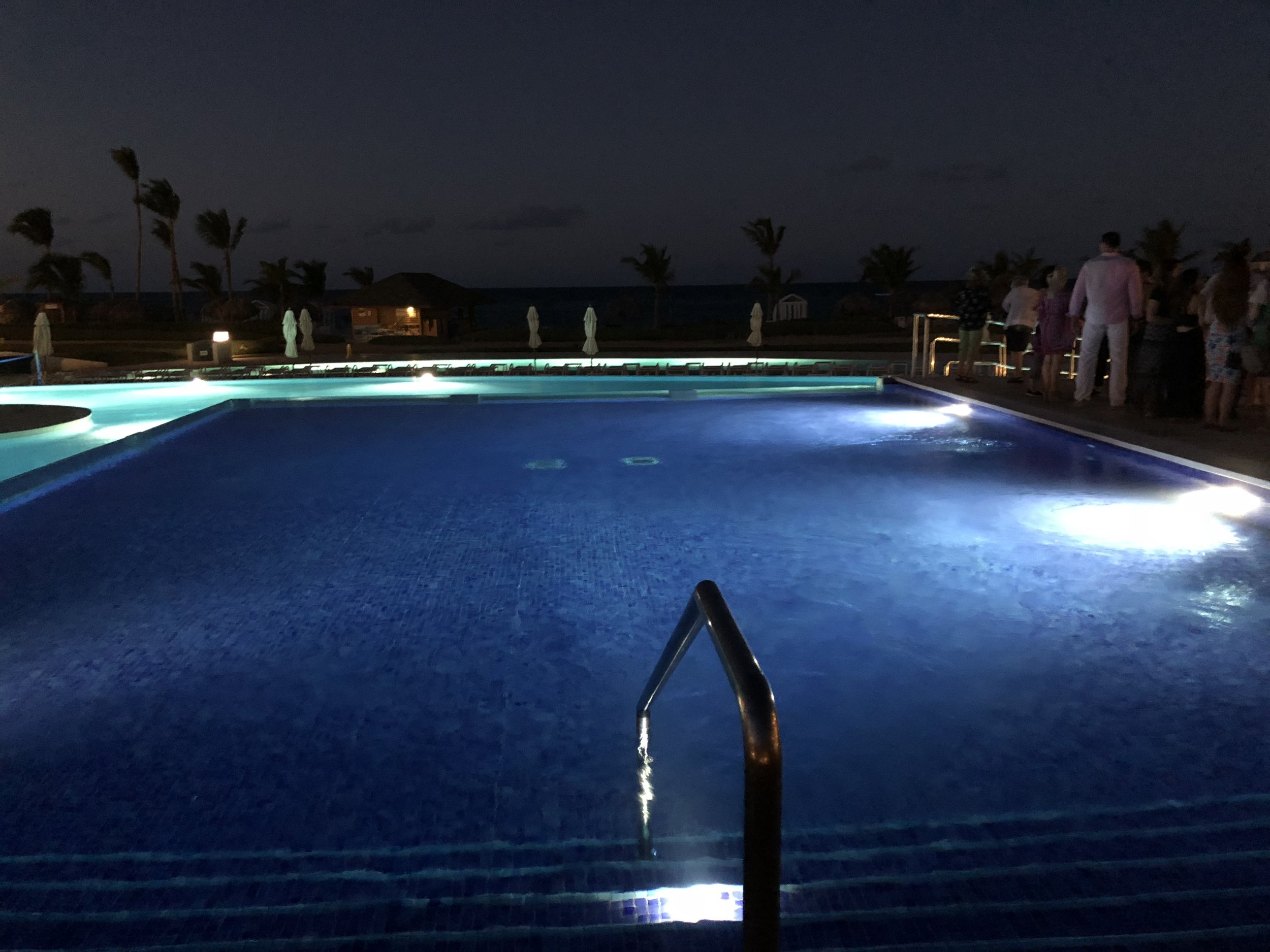 A night view of the main infinity pool.