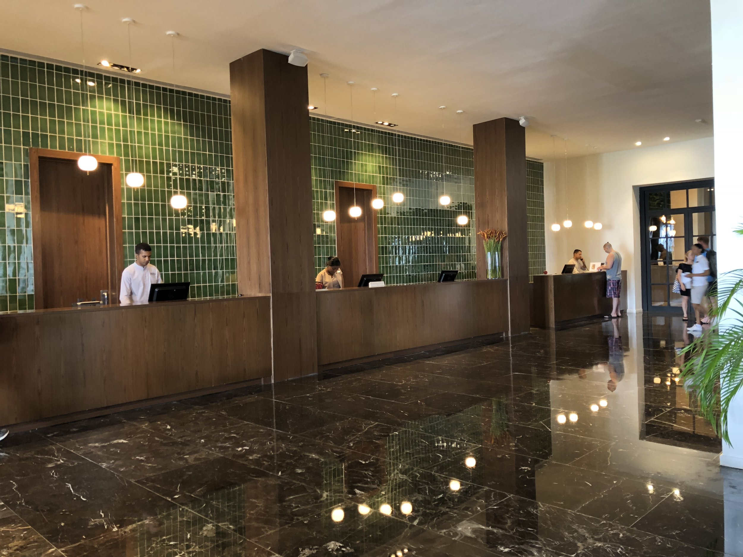 The front desk is on the left hand side of the upper part of the main lobby.