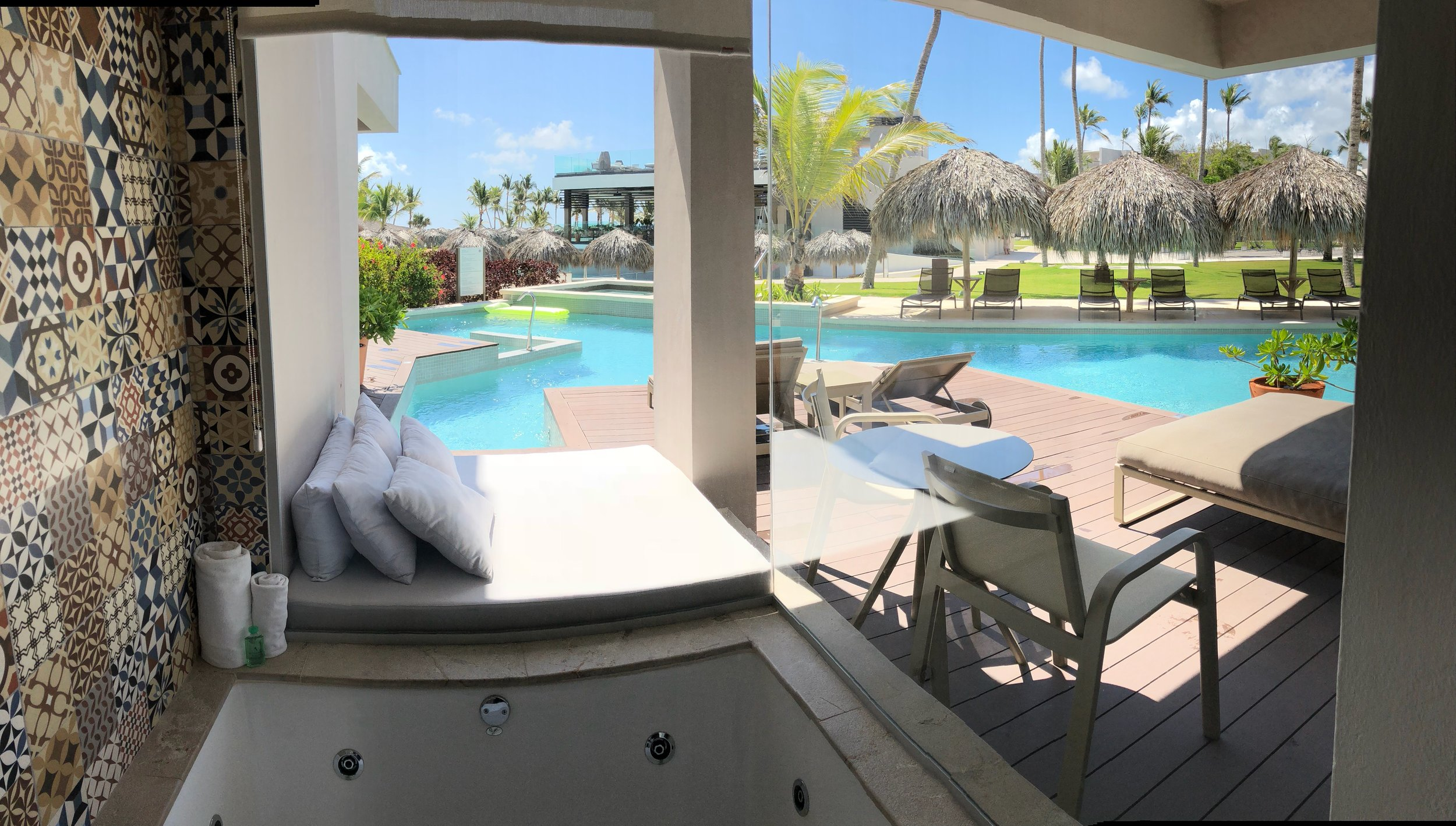 Room Type: Junior Swim up Suite with Deck  Jacuzzi is located on the patio for optimal viewing.