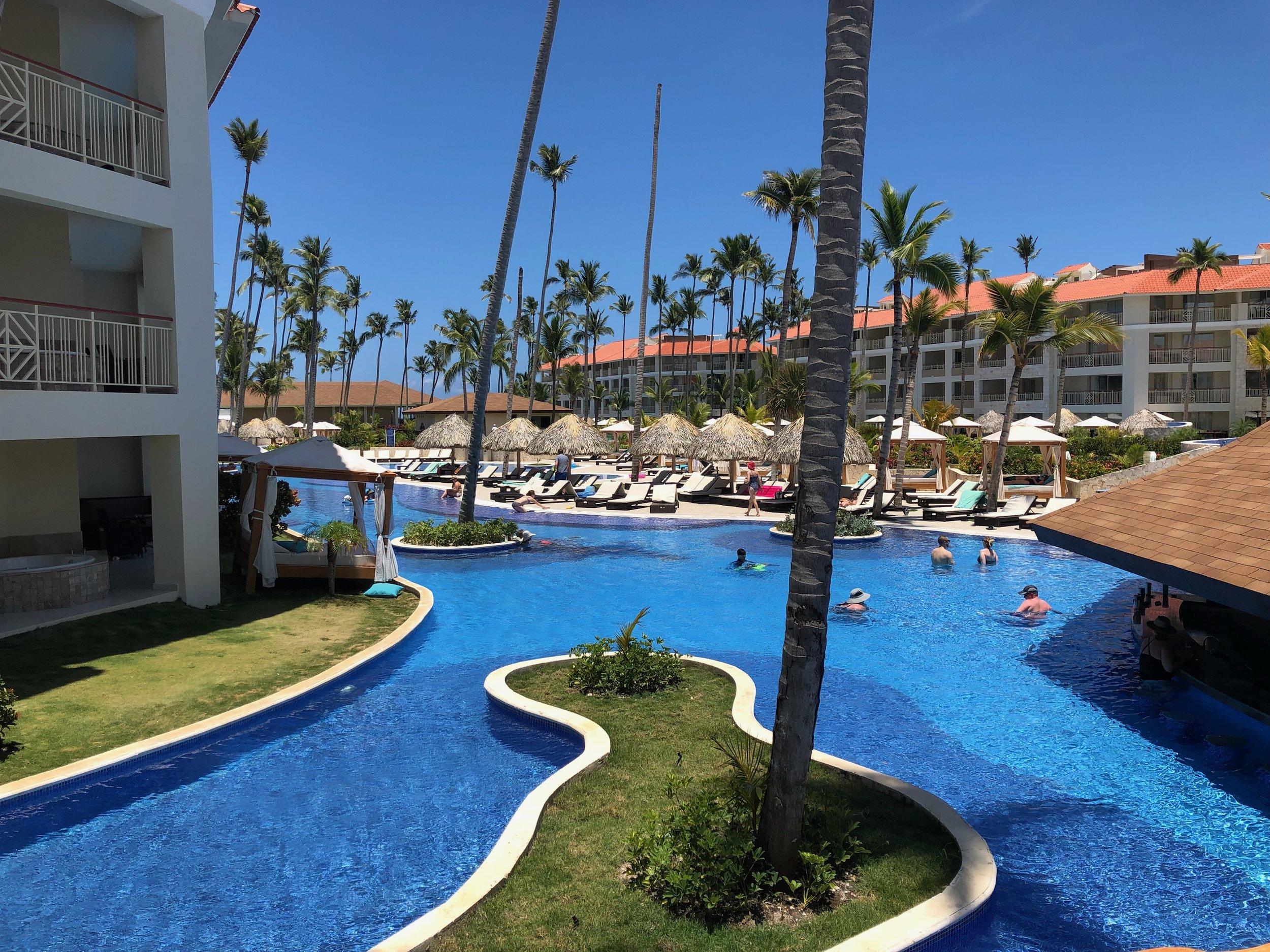 Wonderful winding pool alongside the rooms.