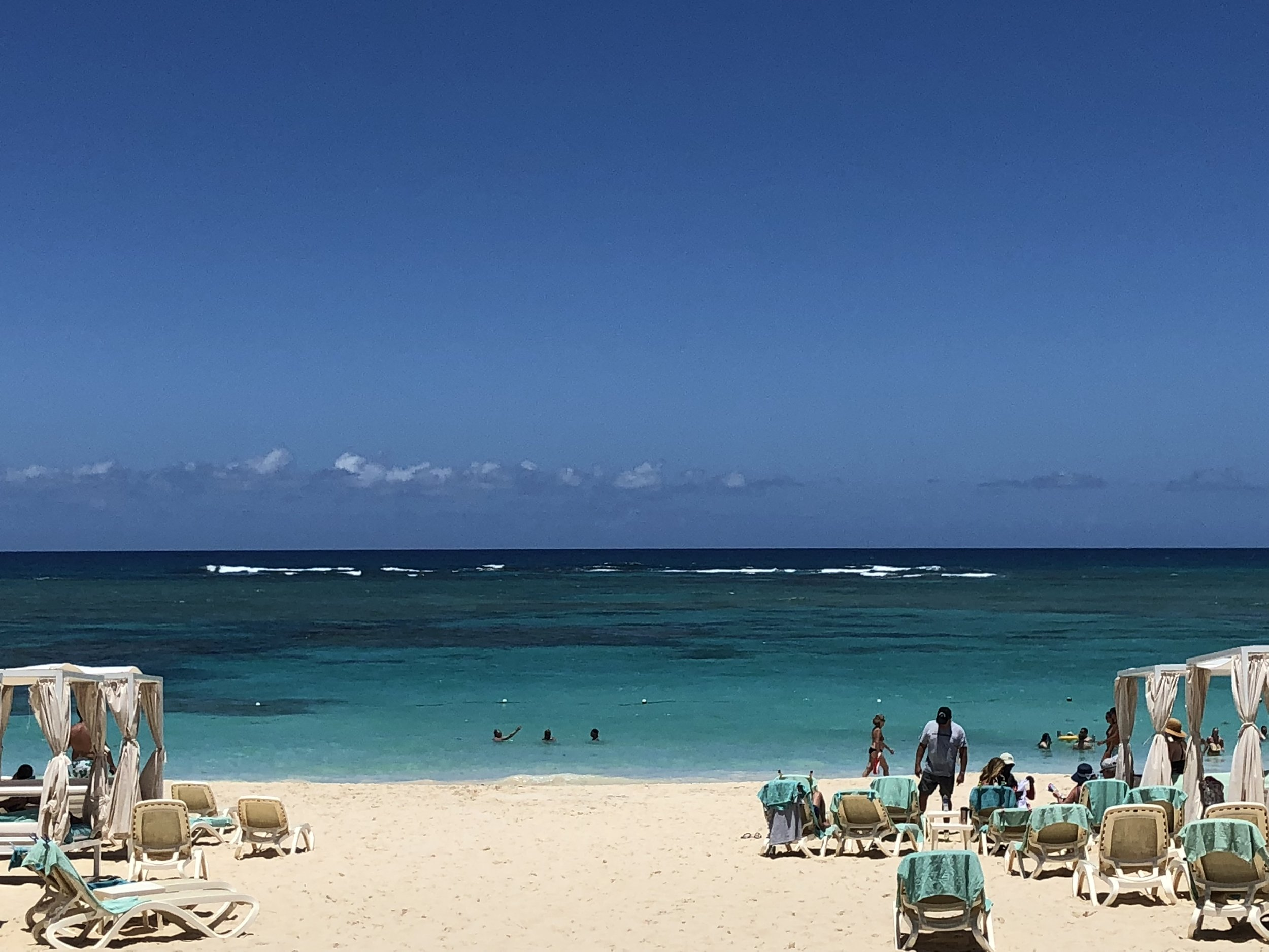 Stunning white sand beaches with blue ocean waves.