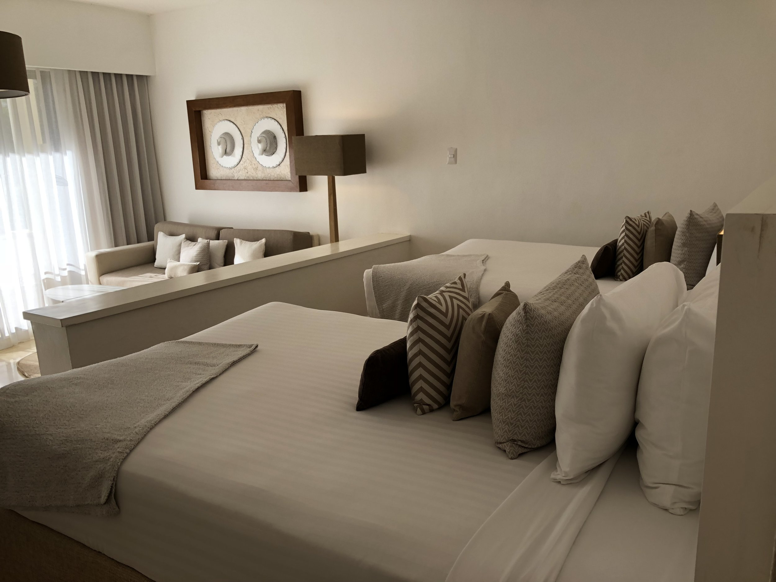 Room Type: Junior Suite  Two queen beds and lounge area.