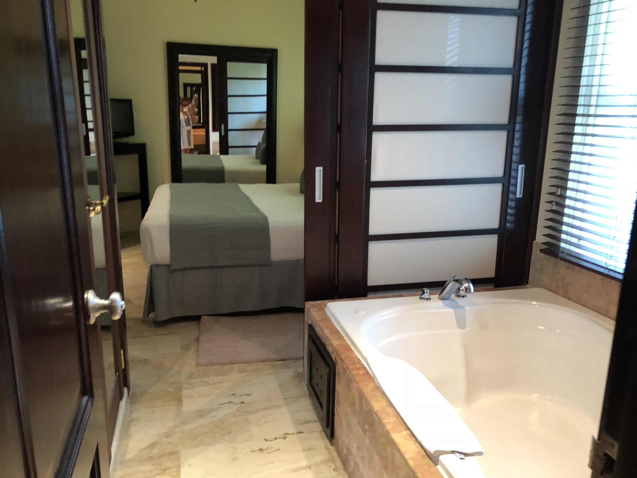 Room Type: Two Bedroom Master Suite  Huge jacuzzi tub next to the window.