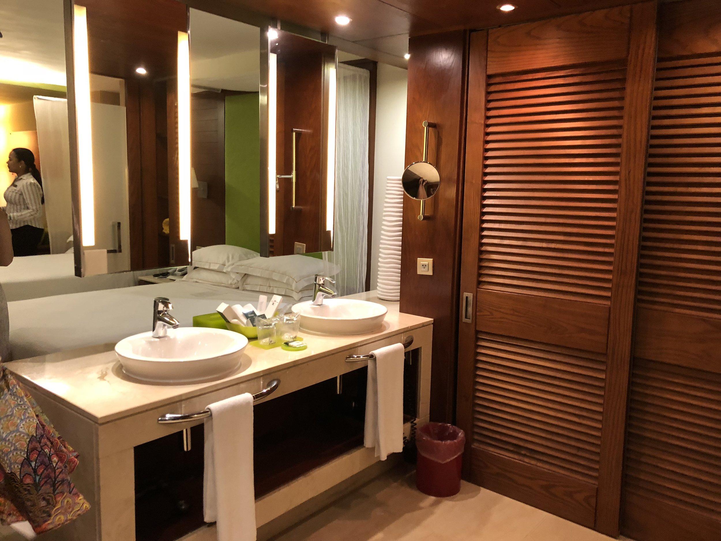Spacious closet and striking bathroom.