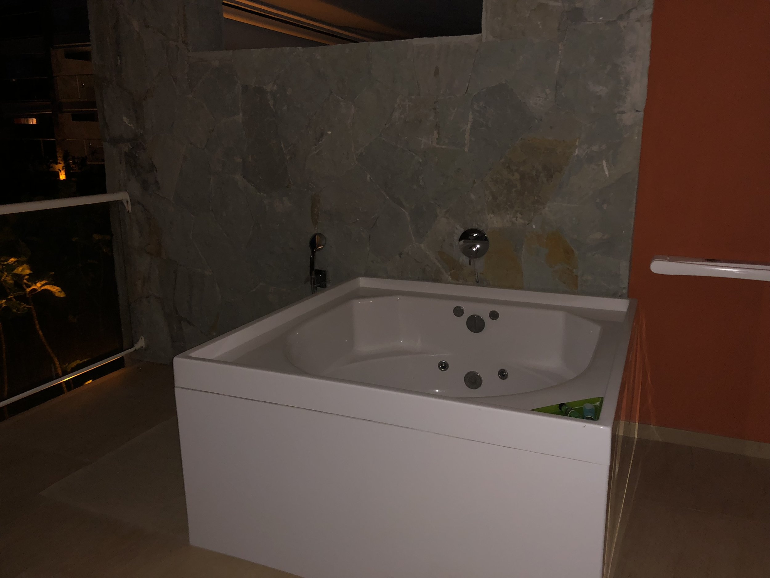 Jacuzzi is located on the balcony.