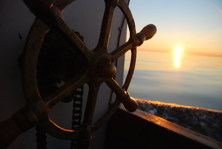 The Spiteful Lady's brass wheel, cog and chain were one of the many gifts. Carl Hedderson, a fisherman from nearby Noddy Bay, gave us the wheel that came off his father's trapskiff.