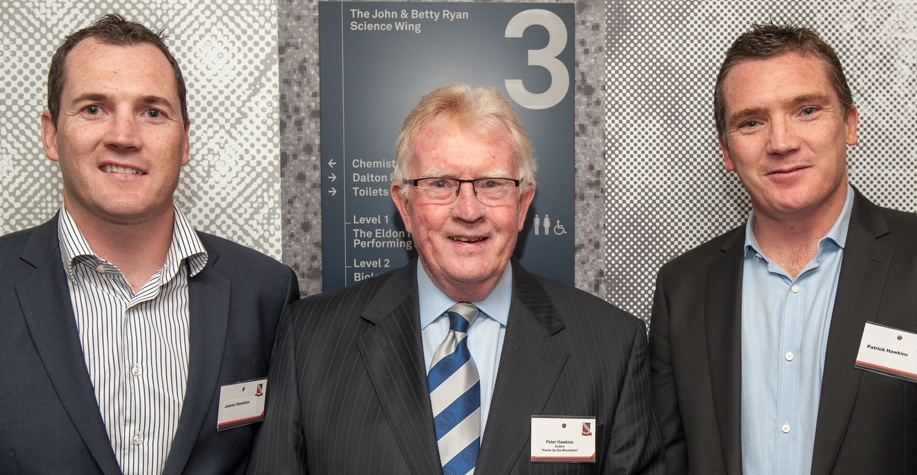 Peter Hawkins flanked by his sons James and Patrick.