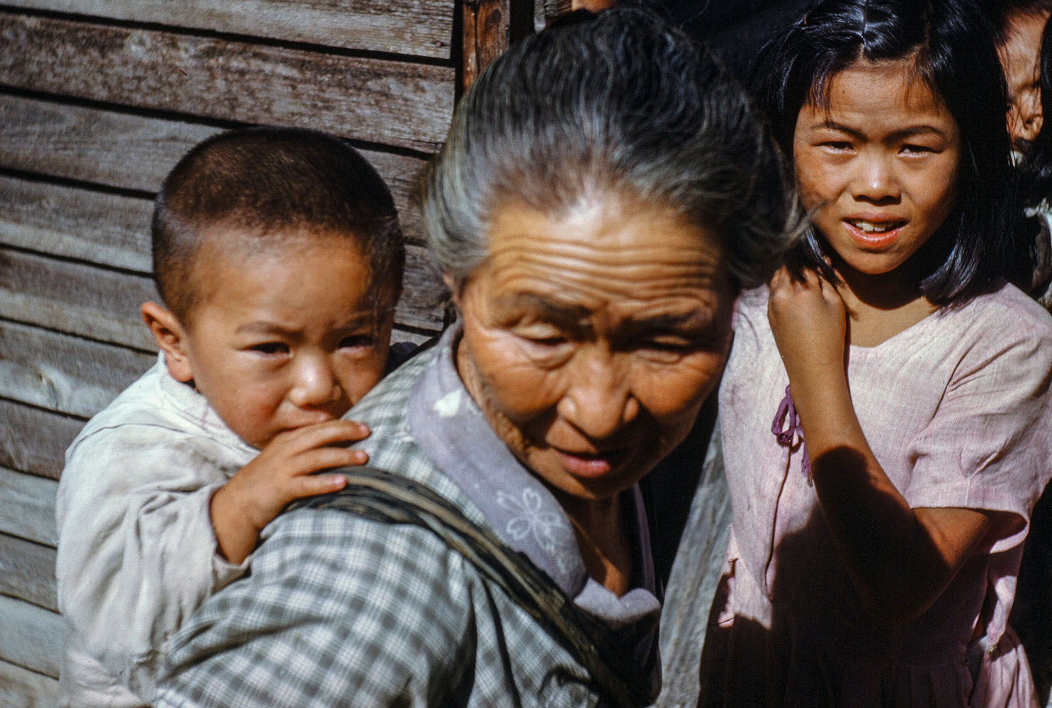 101 Older Woman with Baby on Back, Young Girl