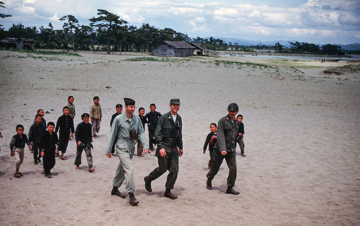 56- American Soldiers Being Followed by Children