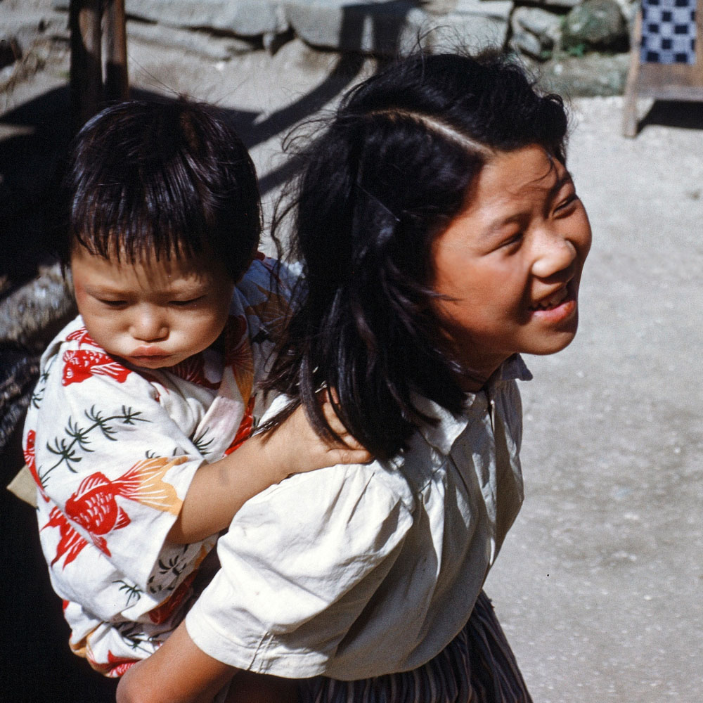 306- Young Girl with Baby