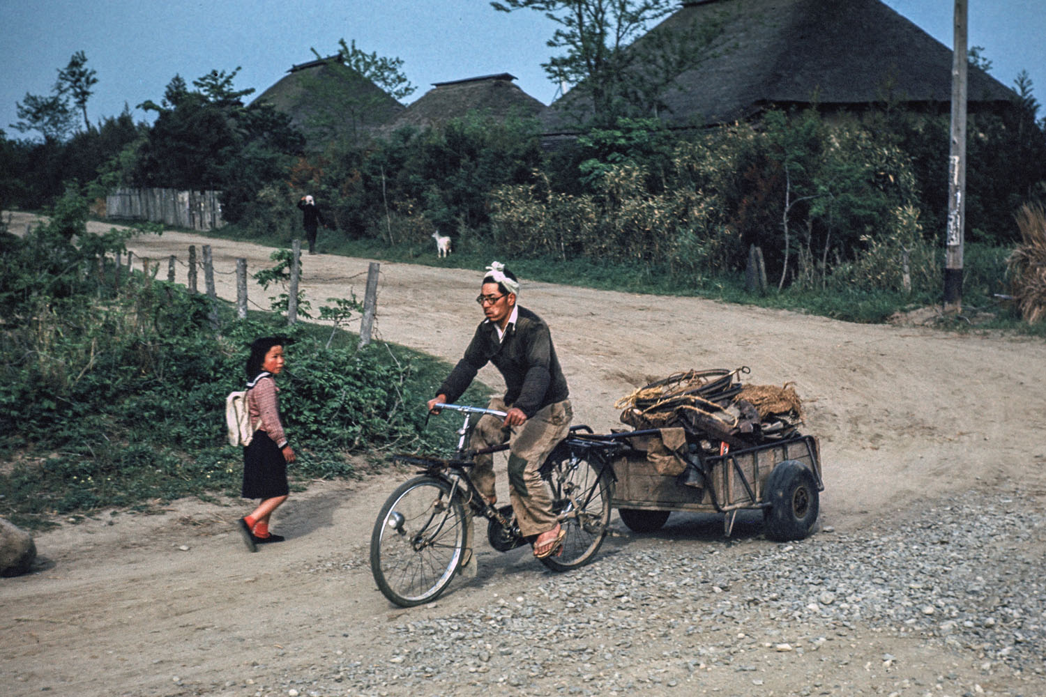 346-Man on Bicycle Pulling Cart