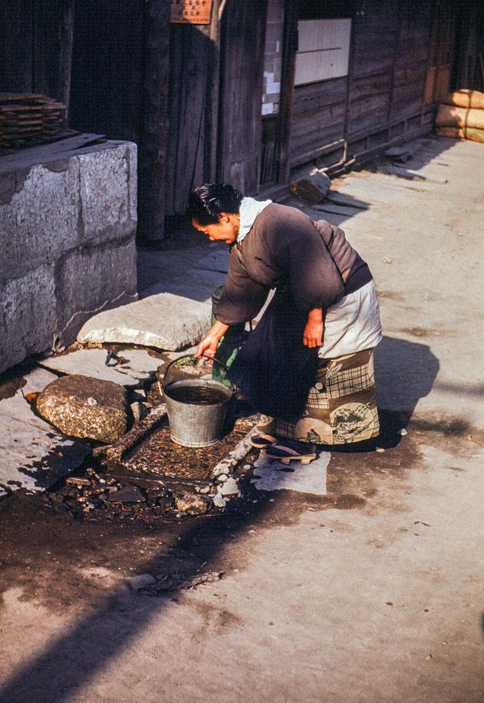 361-Woman Getting Water