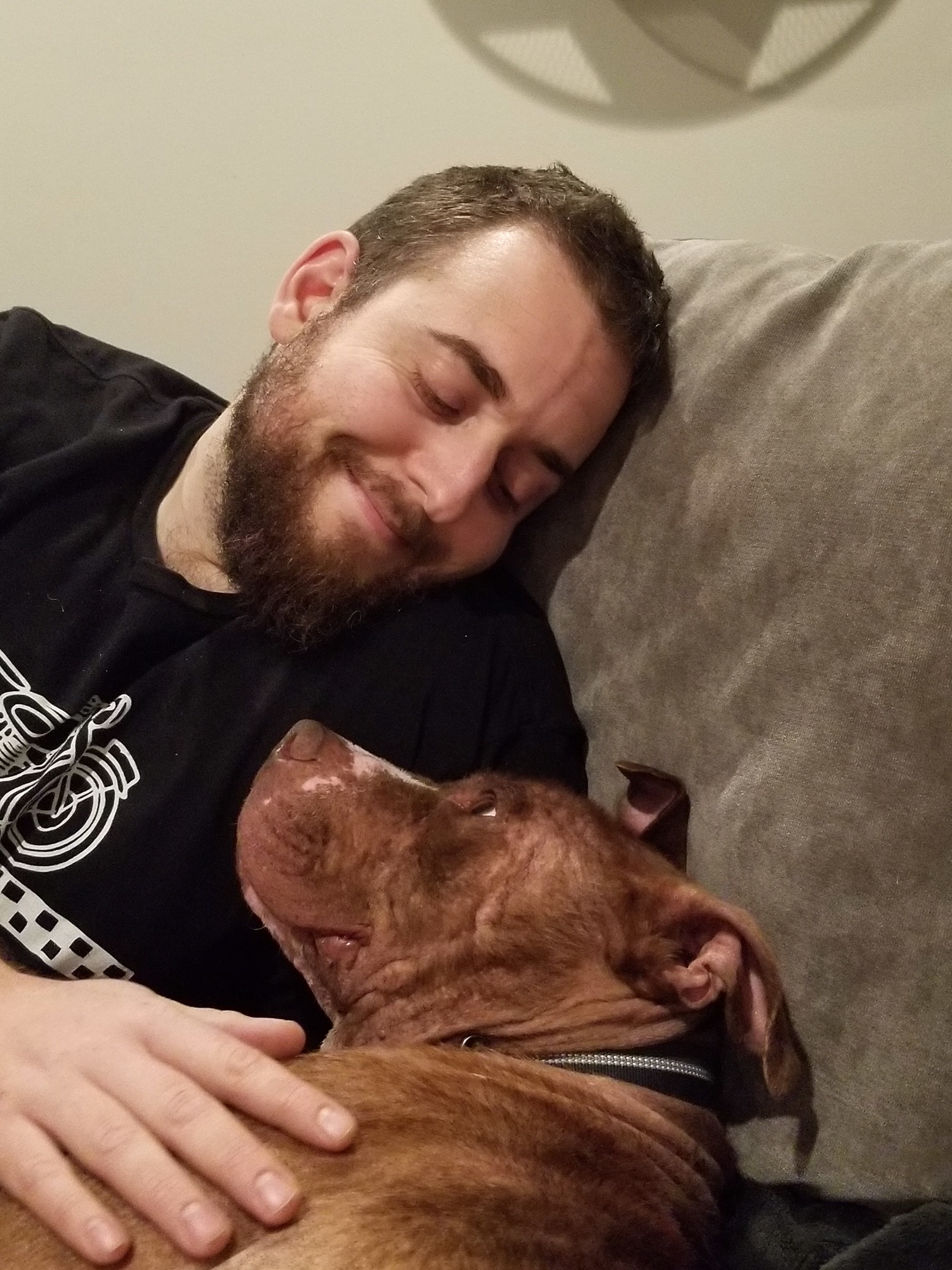 Franklin snuggles up at home with his new dad, Nick.