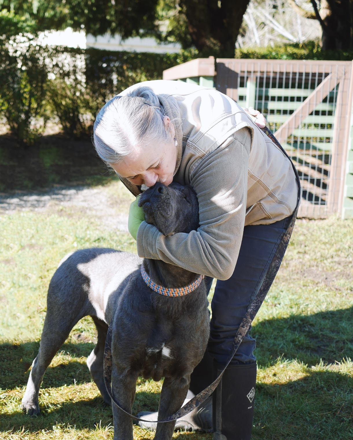 Del Norte Animal Control Shelter volunteer Sandy loves on Gracie, an abused and neglected dog in their care.