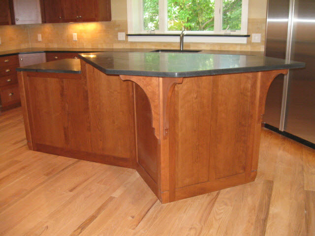 custom-solid-cherry-kitchen-island-with-black-granite-counter-top-and-architectural-brackets-2.jpg