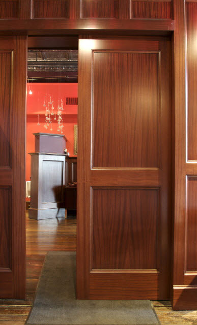 ninas-restaurant-done-in-quarter-sawn-sapelle-hard-wood-traditional-panel-moulding-with-pocket-doors-10.jpg