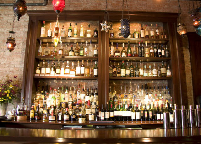 ninas-restaurant-liquor-shelving-done-in-quarter-sawn-sapelle-hard-wood-with-crown-moulding-2.jpg