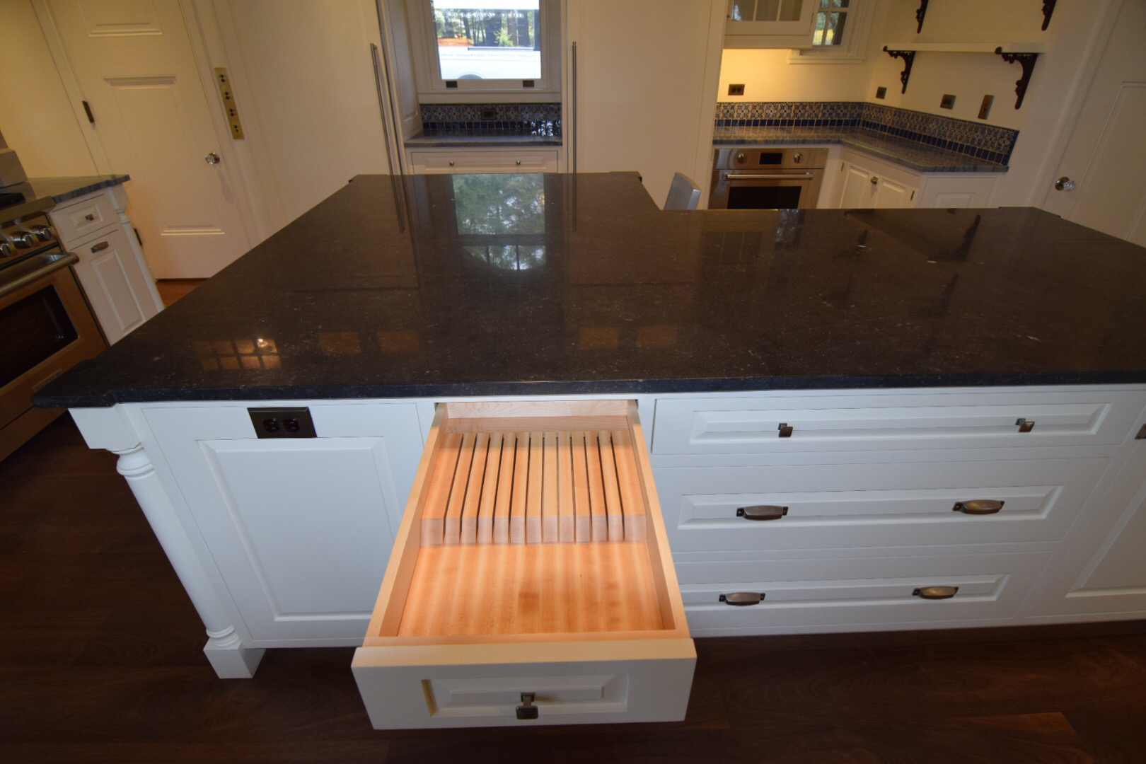 built-in-cooks-knife-drawer-in-custom-white-lacquer-kitchen-with-hard-maple-face-frame-cabinetry-with-inset-doors-and-raised-panels.jpg