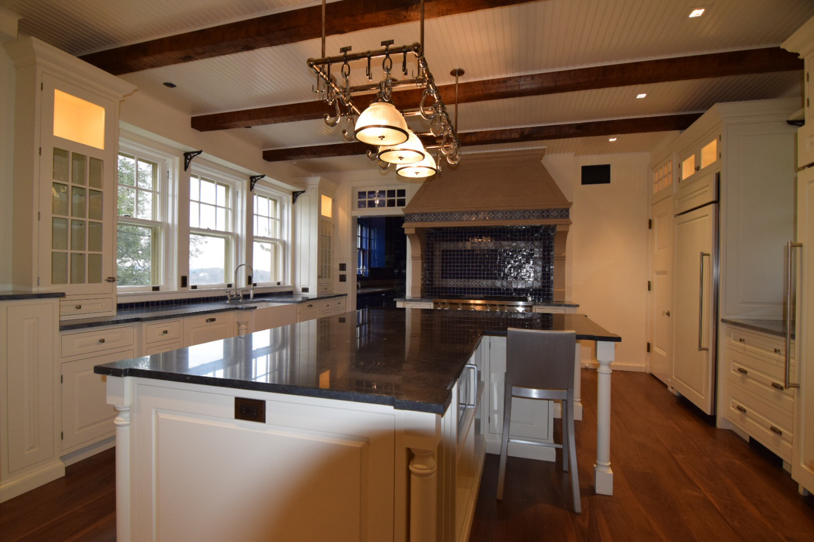 custom-kitchen-with-white-lacquered-hard-maple-cabinetry-inset-doors-and-raised-panels-and-granite-countertop.jpg