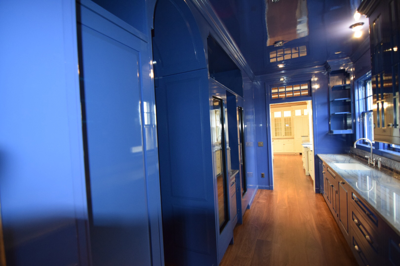 butlers-pantry-kitchen-in-high-gloss-blue-finish-from-floor-to-ceiling.jpg