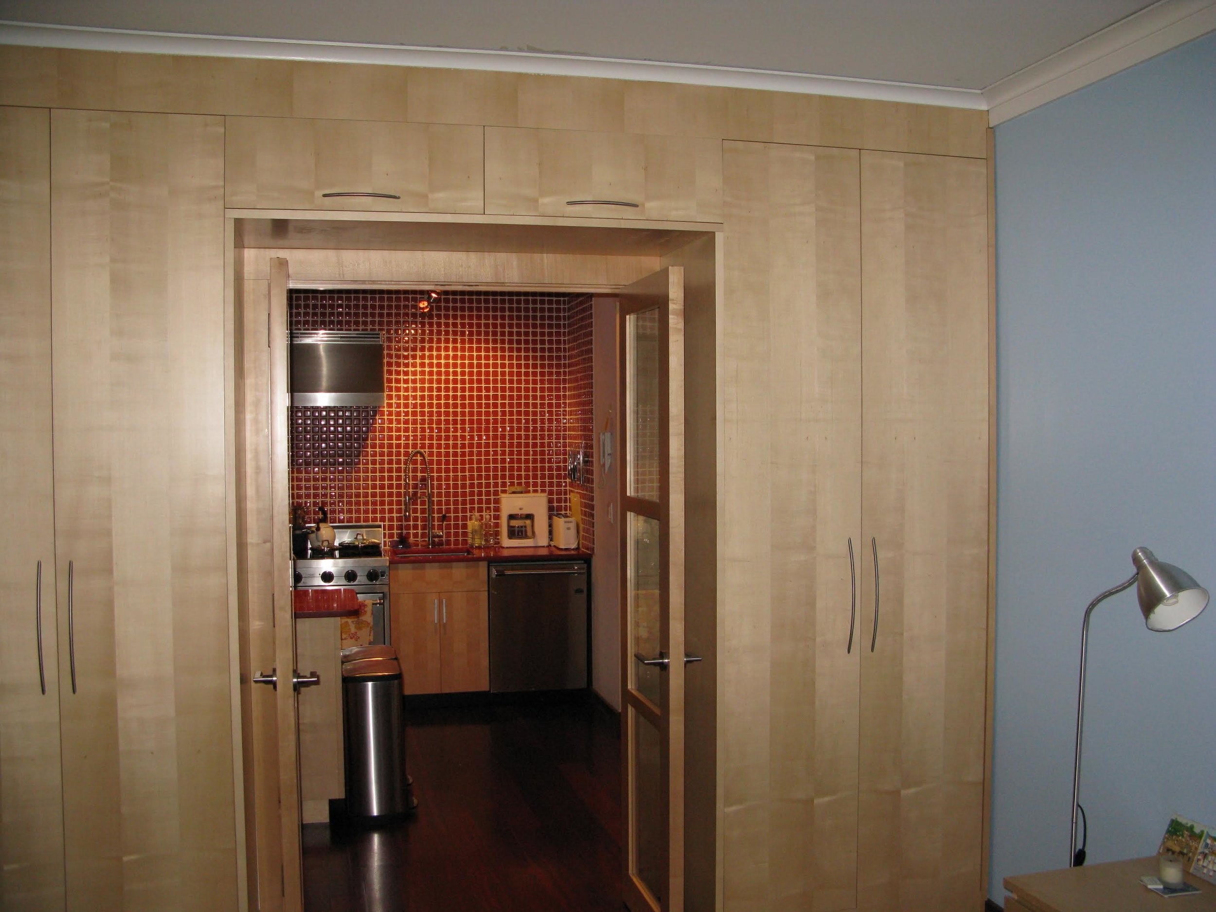 custom_quarter-sawn_maple_bookmatched_veneer_cabinetry_for_NYC_studio_apartment.jpg