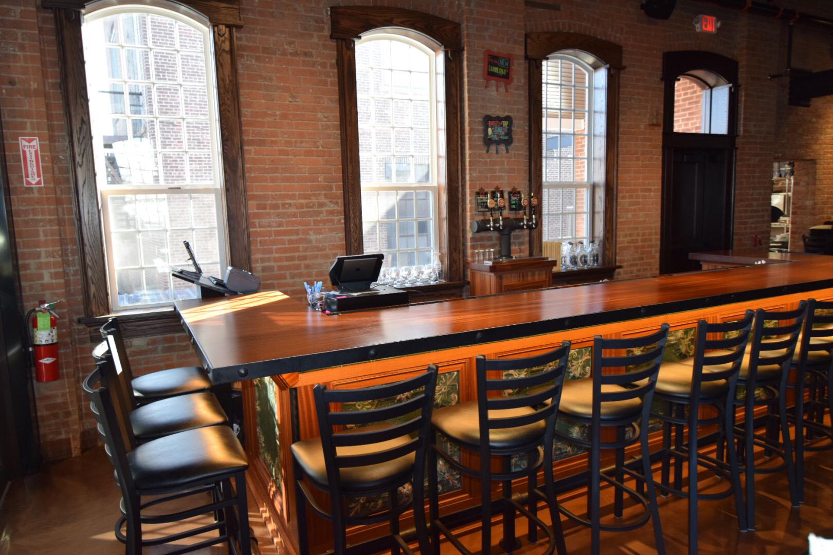 sapele-bar-and-white-oak-radius-window-tops-and-white-oak-door-with-white-oak-transom-clemson-brewing.jpg