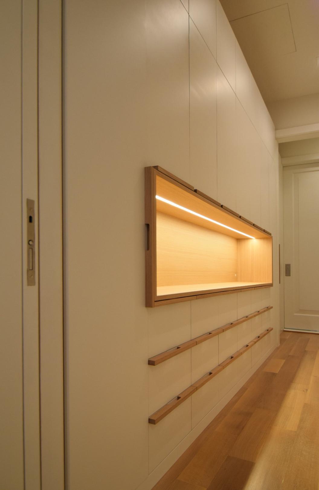 custom-walk-in-closet-drawers-white-lacquer-finish-maple-interior-white-oak-handles-and-white-oak-accent-open-cabinet.jpg