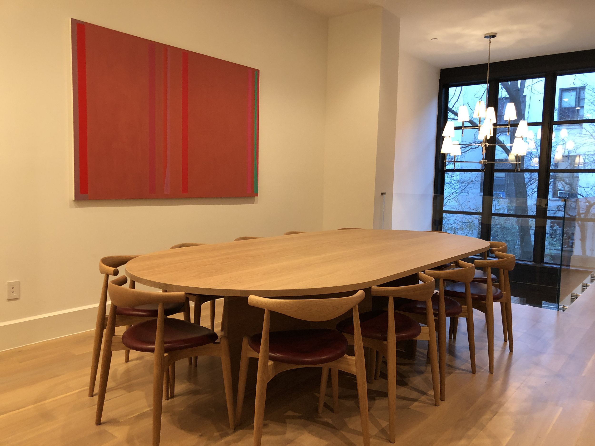 custom-oval-solid-white-oak-table-with-natural-oil-finish-10-feet-long-by-5-feet-wide-with-1.25-inch-thick-table-top-and-base.jpg