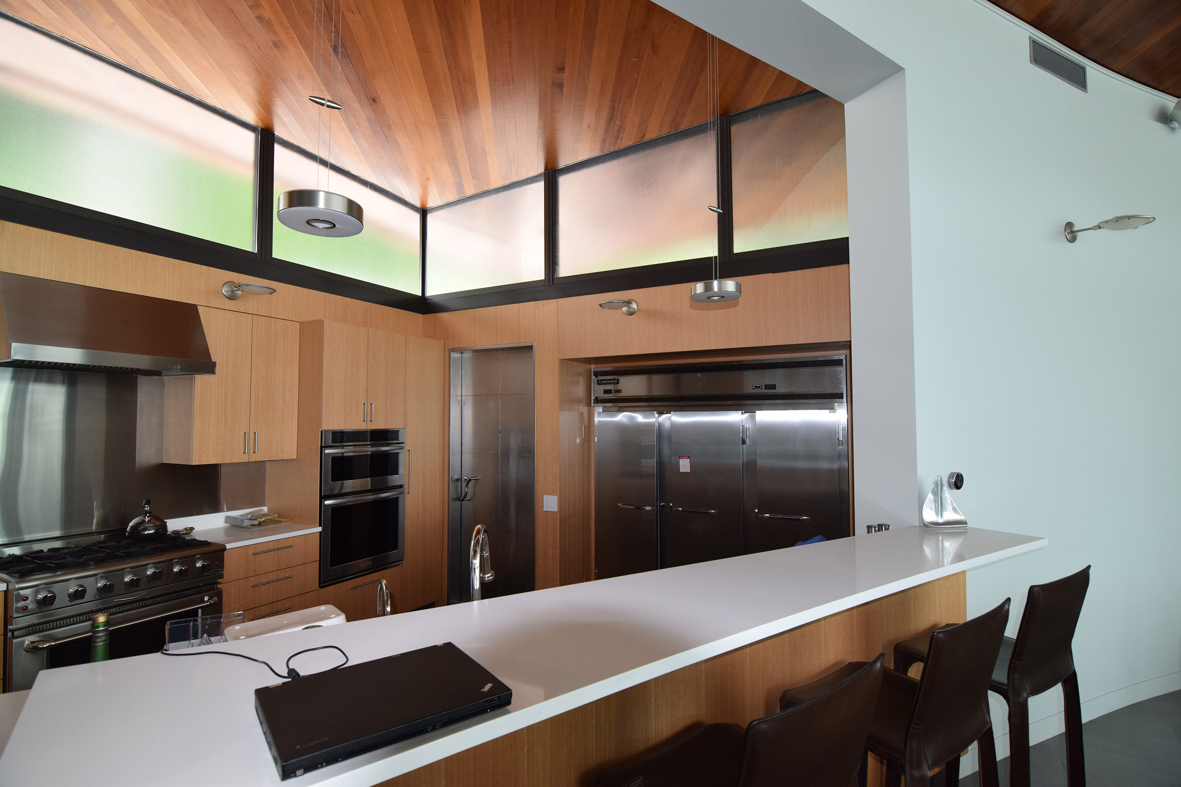Rift Anigre Custom Kitchen Cabinets & Breakfast Counter Paneling