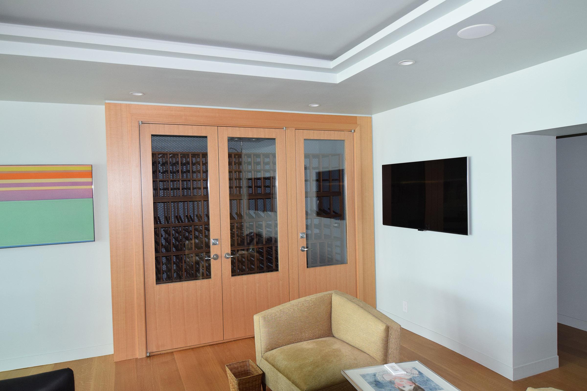 Custom Rift Anigre Wine Closet with Walnut Interior