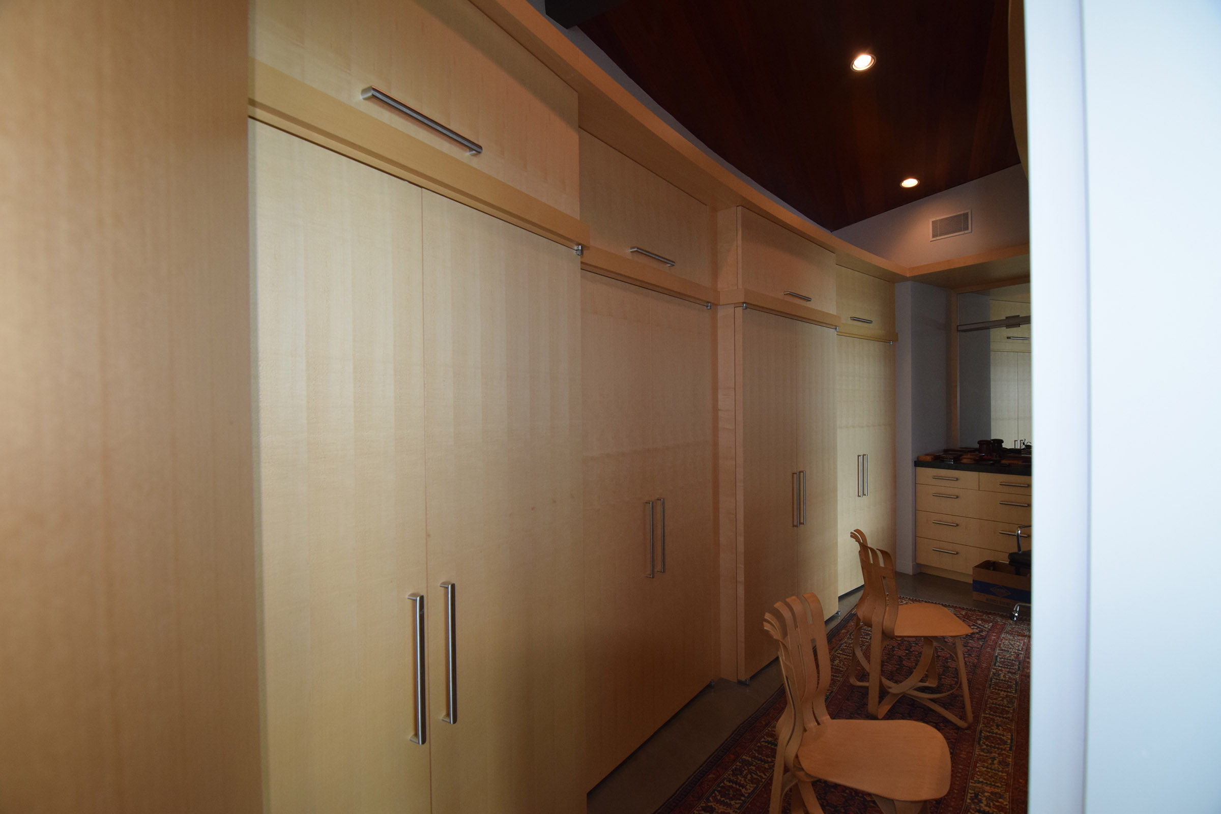 Rift Anigre Custom Closets on a curve with Matching Dresser & Mirror
