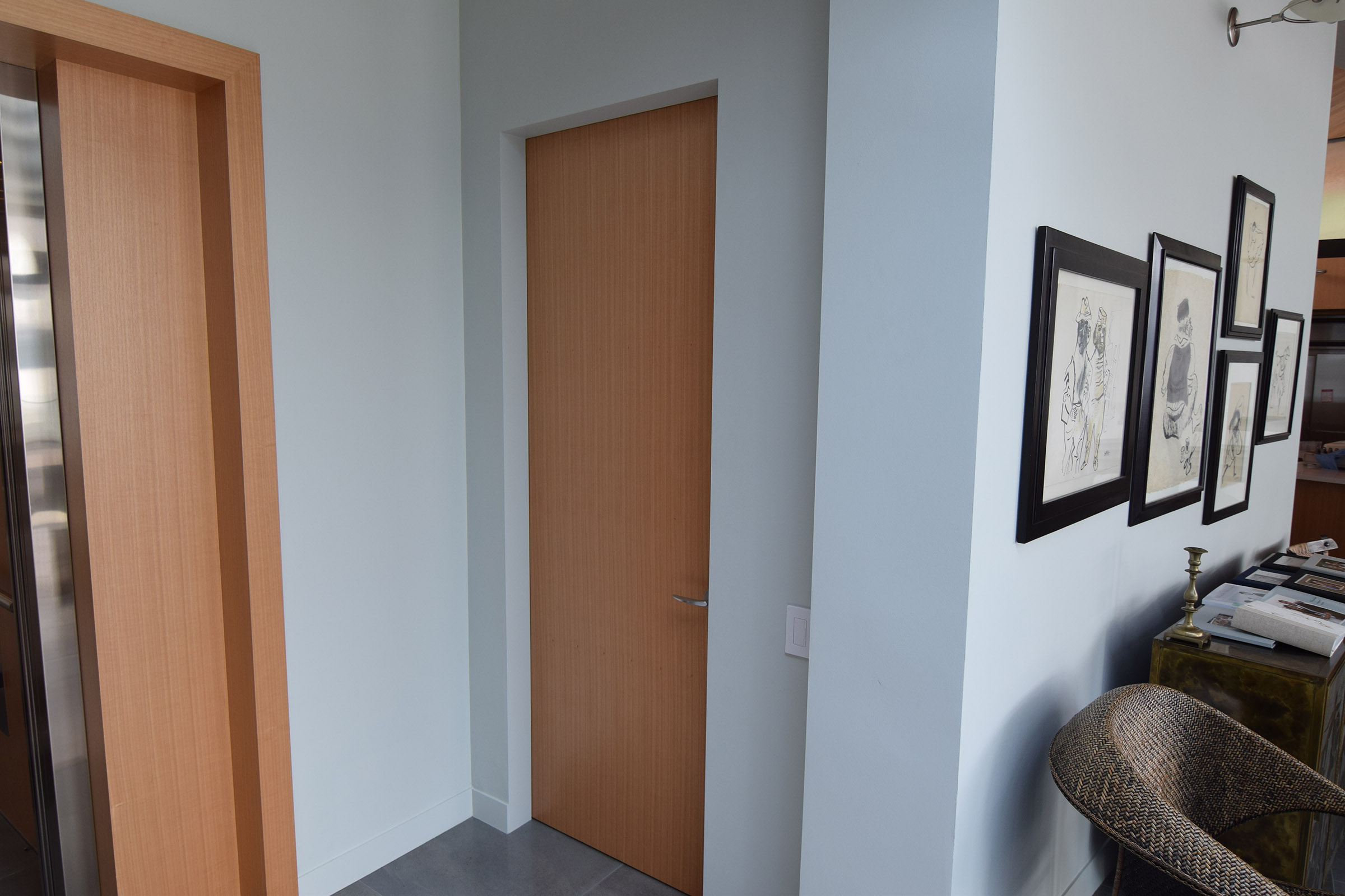 Custom Rift Anigre Elevator & Closet Door