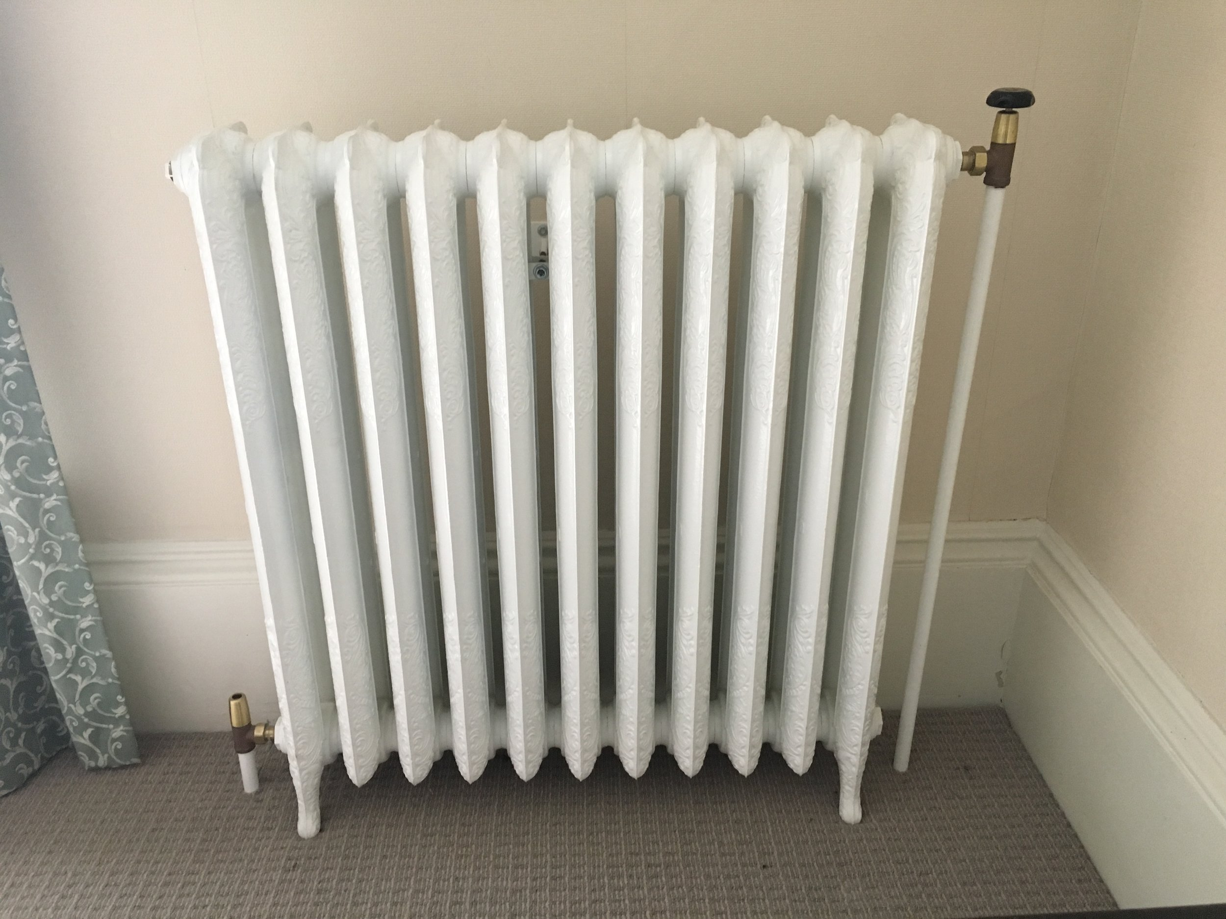 Traditional cast iron radiator in Melrose House