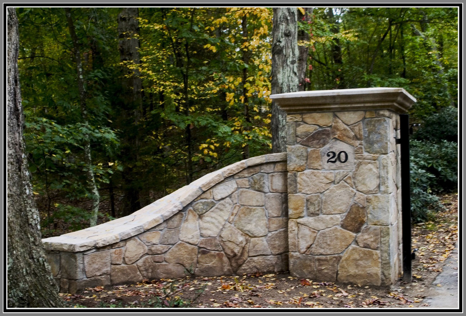 Driveway columns, lights and walls by Artistic Outdoors