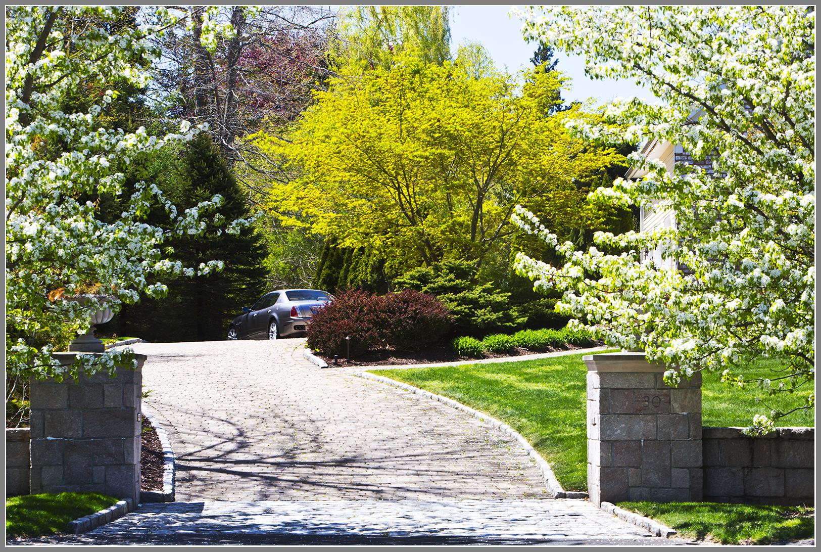 Granite Columns, wall, cobblestone apron and paver driveway