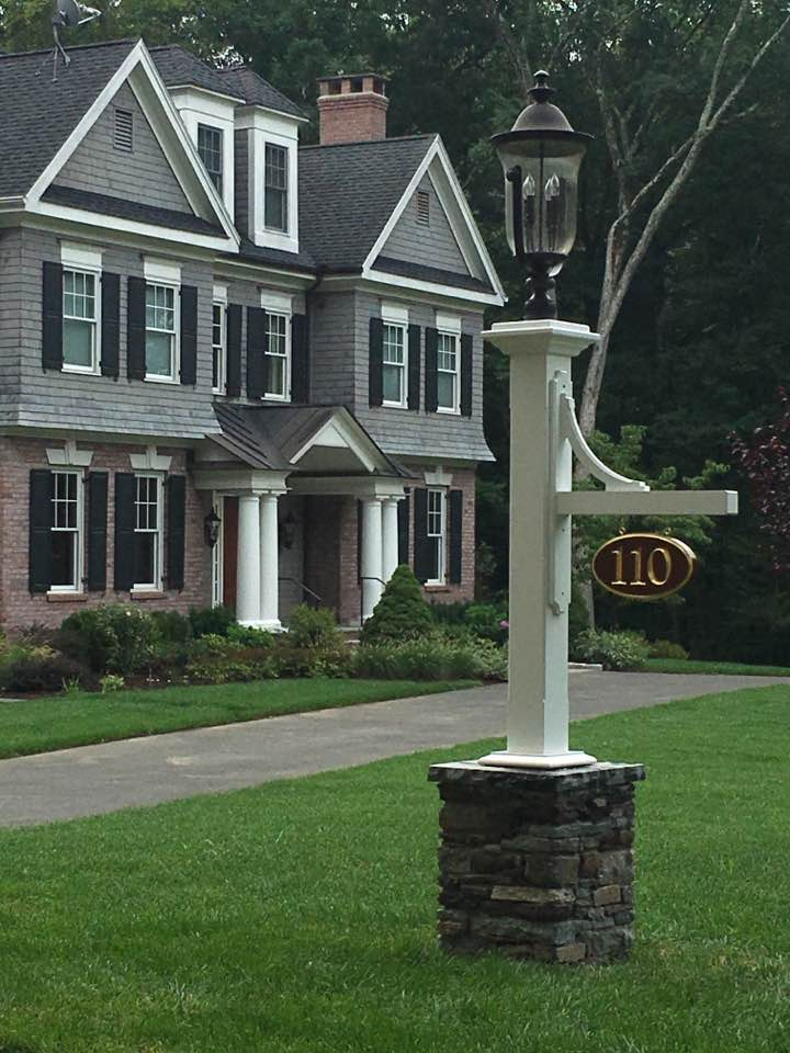 Driveway light with stone foot column by Artistic Outdoors
